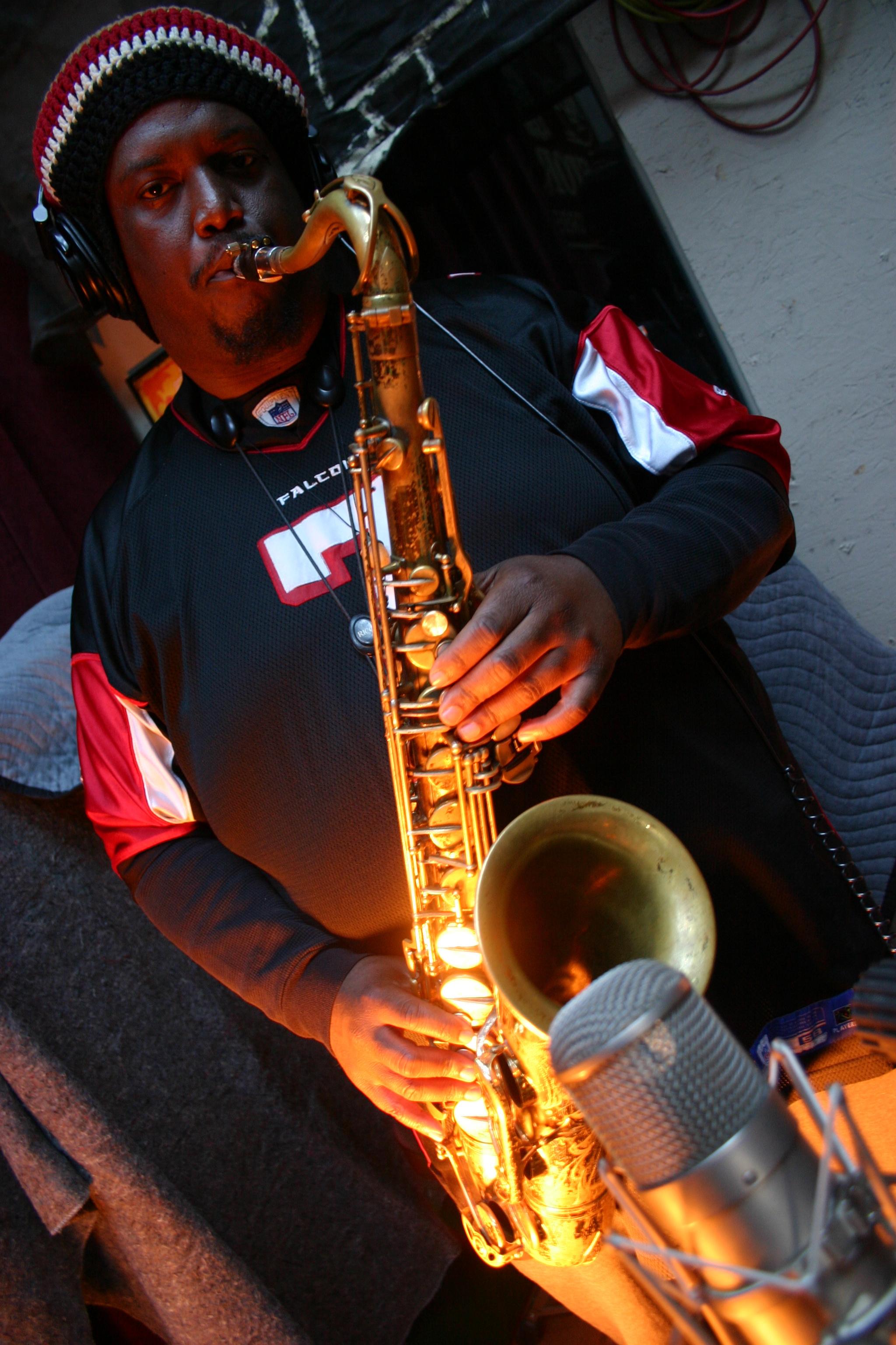 """Kamasi Washington playing a saxophone with the band """"Throttle Elevator Music."""""""