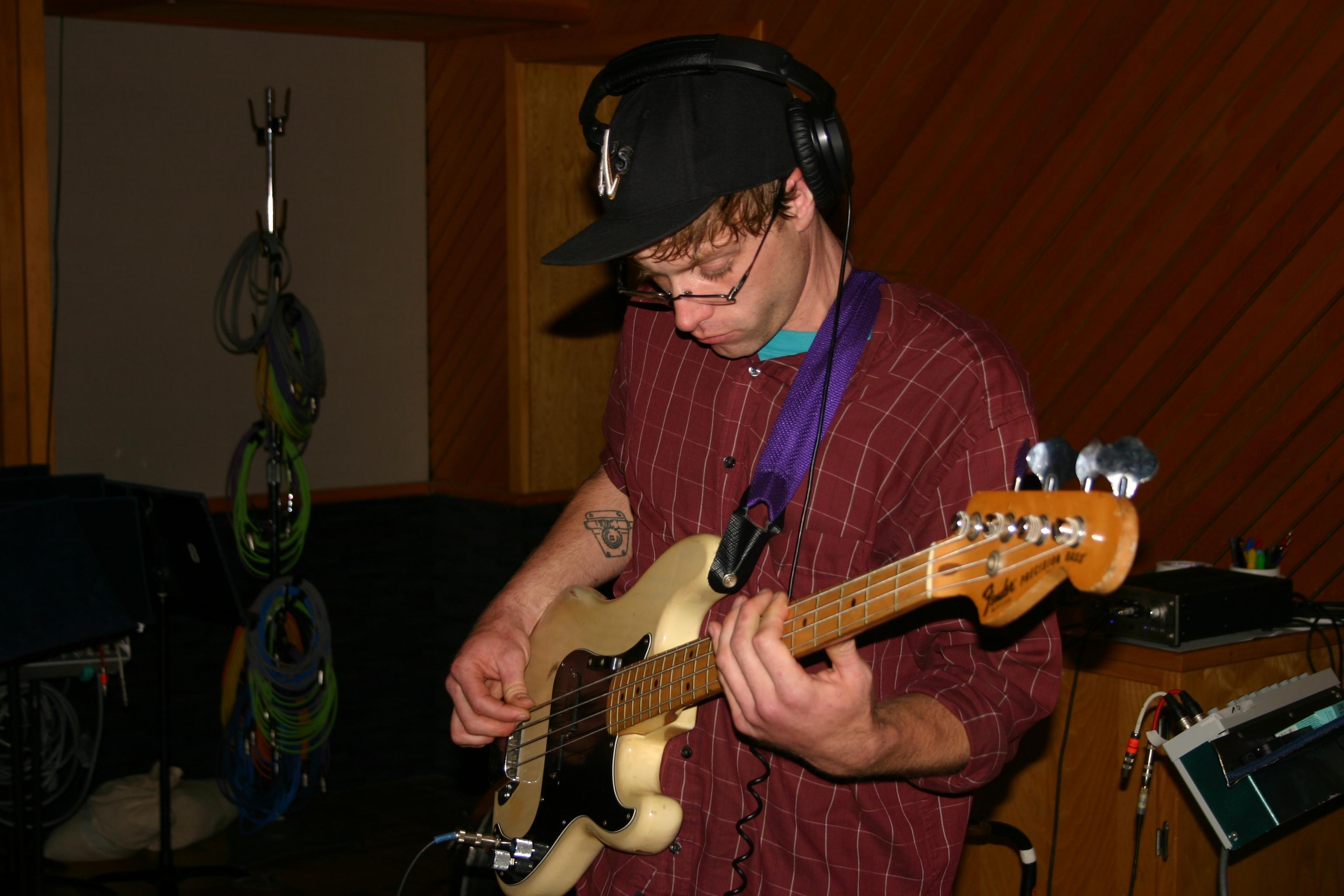 Matt Montgomery playing a bass with Throttle Elevator Music.