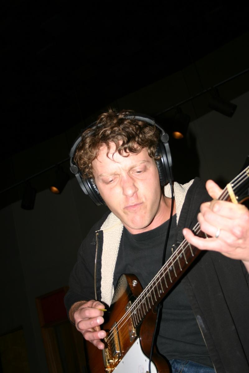 "Mike ""Lumpy"" Hughes playing guitar."