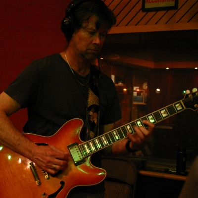 Dave MacNab playing a guitar.