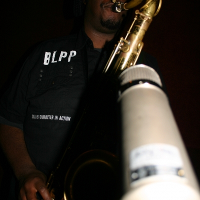 """Kamasi Washington, playing a saxophone on the Throttle Elevator Music album """"Area J."""""""