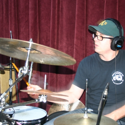 """Mike """"Lumpy"""" Hughes, playing drums on the Throttle Elevator Music release, """"Jagged Rocks."""""""