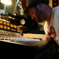 A photo of Gregory Howe at the sound board.